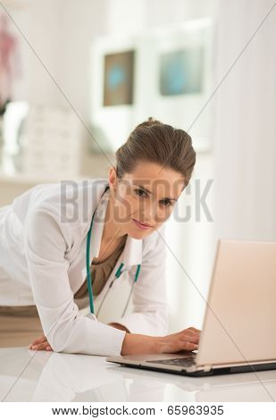 Portrait Of Medical Doctor Woman Working On Laptop In Office
