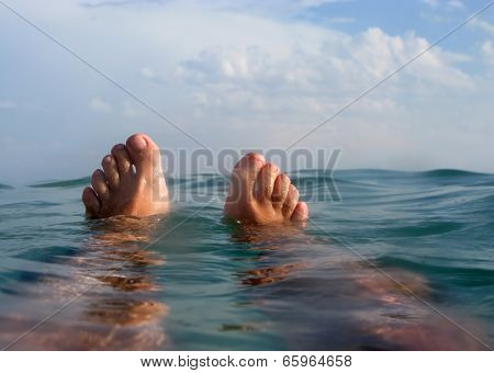Man Floating On The Beach In Vacations