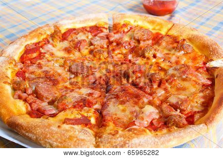 Meat Deluxe Pizza.
