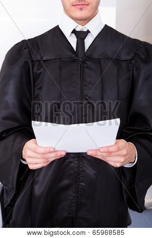 Male Judge Holding Documents