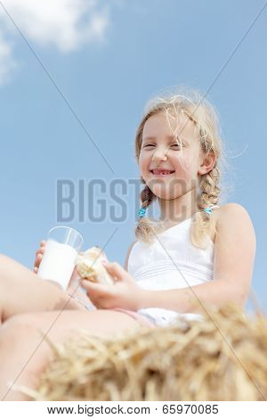 Happy Blond Girl Eating