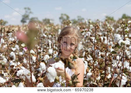 Portrait Of A Girl In A Field Of Cotton