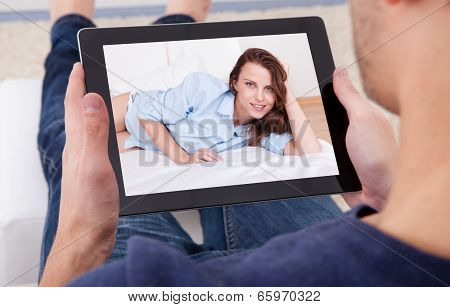 Man Video Chatting On Digital Tablet