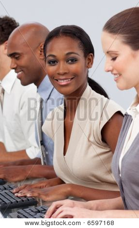 Afro-american Businesswoman Sitting In A Line With Her Colleagues
