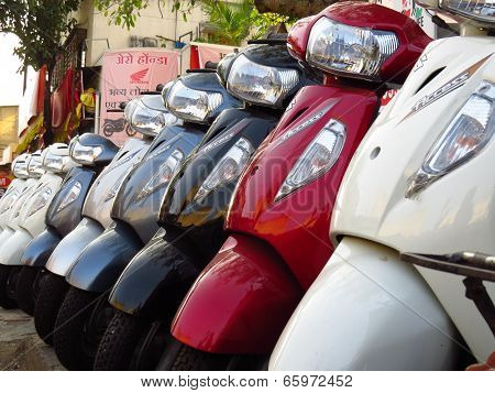 Suzuki Scooters For Sale Next To A Honda Shop In India