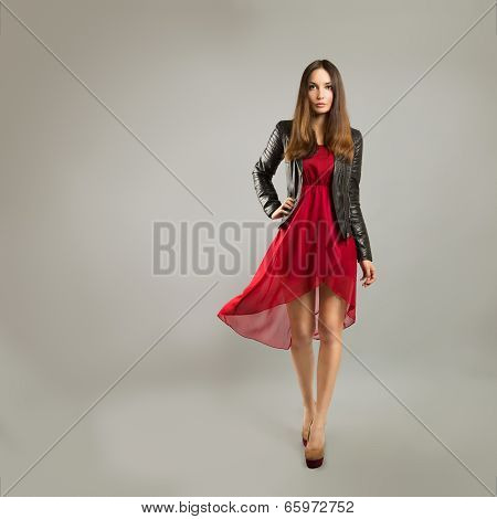 Woman in Red Dress on Gray Backgound