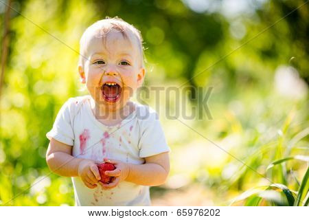Happy baby with strawberry