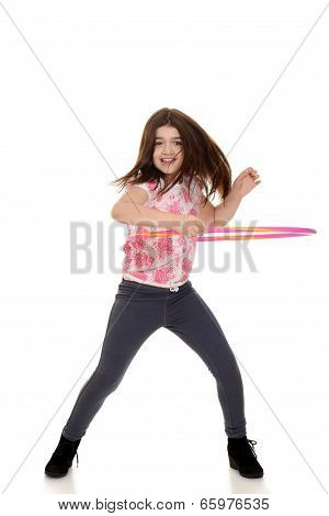 child doing hula hoop with motion blur