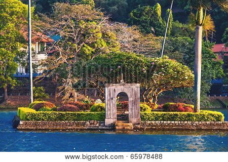 Small Island With Palm Trees In The Middle Of Kandy Lake