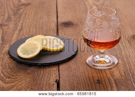 Luxure Cognac In Decorated Crystal Glass And Lemon