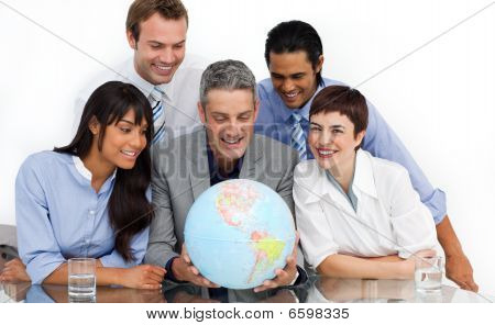 Smiling Multi-ethnic Business Partners Holding A Globe