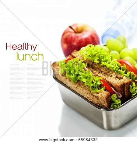 Lunch box with sandwiches, fruits  and water on white background