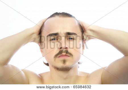 Attractive Man Holding His Head