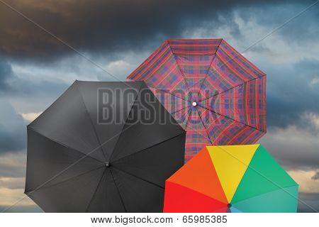 Open Umbrellas With Storm Grey Clouds