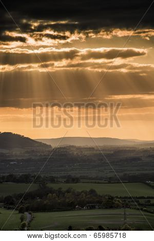 Stunning Summer Sunset Across Countryside Landscape With Dramatic Clouds