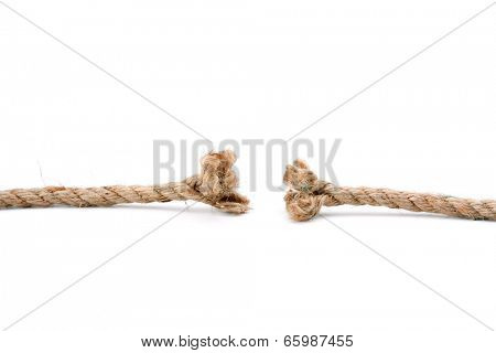A close-up of a repture of a brown rope isolated on white background