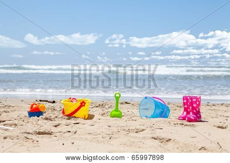 Brightly Colored Plastic Beach Toys On The Beach