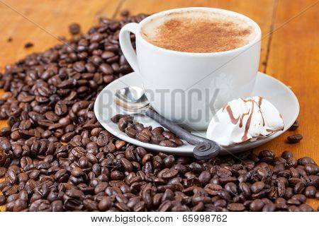 Freshly Brewed Cup Of Coffee Served With Meringue