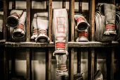 stock photo of firefighter  - Storage room in firefighting depot with water hoses - JPG
