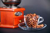 foto of wooden box from coffee mill  - vintage coffee grinder with a cup of beans - JPG