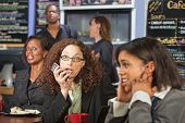 stock photo of disrespect  - Upset customers in cafe with loud woman on phone - JPG