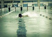 image of swim meet  - Professional male swimmer swimming in the pool - JPG