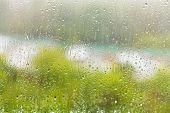 stock photo of raindrops  - rain outside window  - JPG