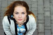 picture of board-walk  - young beautiful girl with blue eyes and red hair walking in the streets - JPG