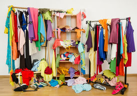 image of messy  - Messy clothes thrown on a shelf - JPG