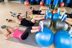 pic of abdominal  - Fitball crunch training group core fitness at gym abdominal workout - JPG