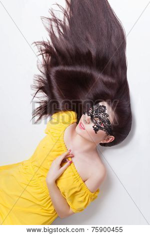 Beautiful woman in lace carnival mask