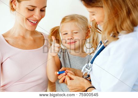 Doctor Taking Blood Test From Small Patient.
