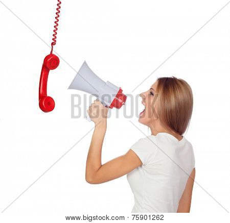 Blonde woman shouting through a phone hanging with a megaphone isolated