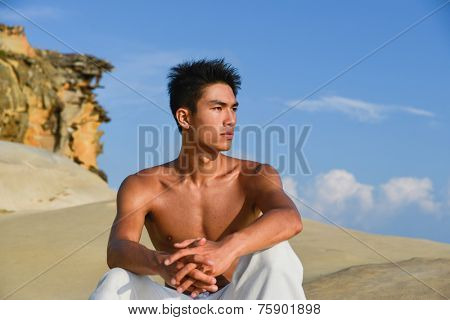 male fitness model in crossfit exercise outdoors. Healthy lifestyle concept.