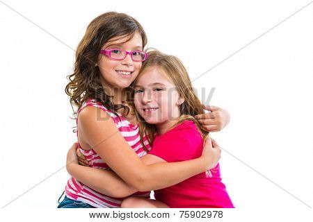 kid girls tender hug smiling ans friends cousins on white background