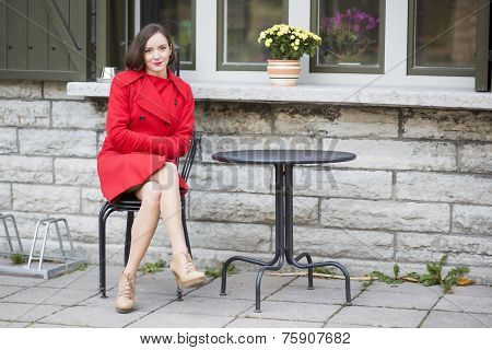 Woman On Metal Chair At Street Cafe