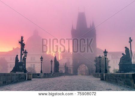 Charles Bridge In Foggy Morning In Prague