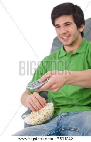 Young Man Holding Remote Control Watch Television