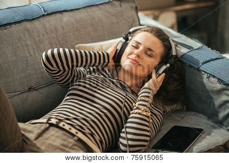 Young Woman Laying On Couch And Listening Music Listening Music