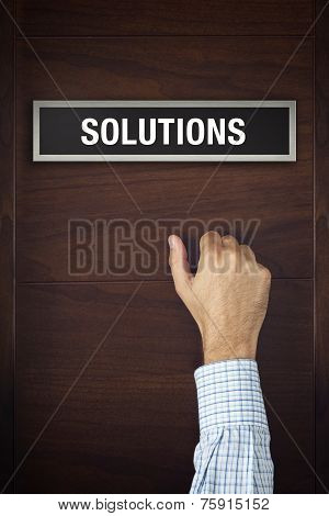 Hand Is Knocking On Solutions Bureau Door