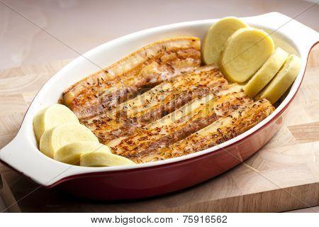 baked pork belly on cumin with potato dumplings