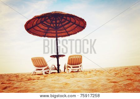 Tropical Beach View With Two Chaise Longues