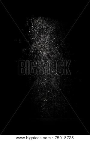 Stop Motion Of White Dust Explosion Isolated On Black Background