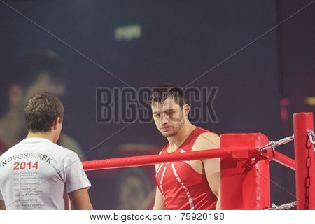 NOVOSIBIRSK, RUSSIA - NOVEMBER 8, 2014: Russian military forces champion Rashid Kodzoyev on the ring during the Friendship Cup. The competitions include 10 kinds of martial arts