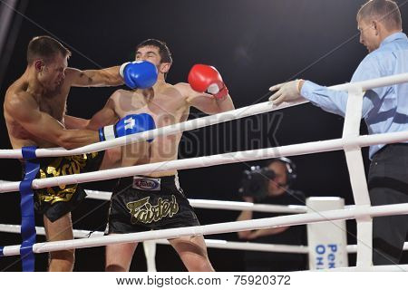 NOVOSIBIRSK, RUSSIA - NOVEMBER 8, 2014: Thai boxing match Valentin Semenov vs Magomed Zainukov during Friendship Cup. The competitions include 10 kinds of martial arts