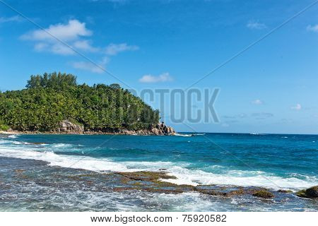 Attractive Beach at Police Bay at Mahe Island, Seychelles with Turquoise Sea Water and White Beach Sand. Captured on Sunny Summer Day.