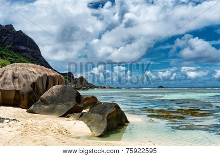 Close up Huge Historic Rocks at Clear Water Lagoon in Anse Source d'Argent in La Digue Island, Seychelles. An Enchanting Trip Destination for Relaxation.