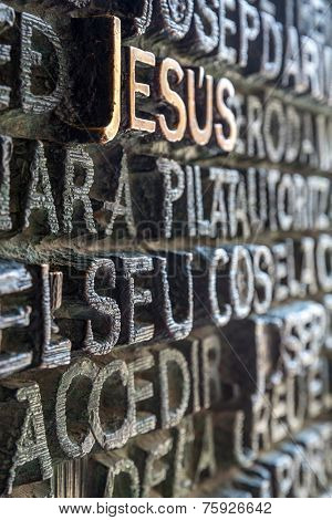 BARCELONA, SPAIN - JUN 10: Words from the Bible in various languages printed on the entrance door of La Sagrada Familia on June 10, 2014 This is the impressive cathedral designed by Antonio Gaudi