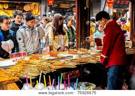 CHONGQING, CHINA - JAN 17: Unidentified merchants are selling traditional food on January  17, 2014 at Ciqikou Ancient Town, Chongqing, China.