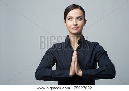 Smiling Woman With Hands Clasped